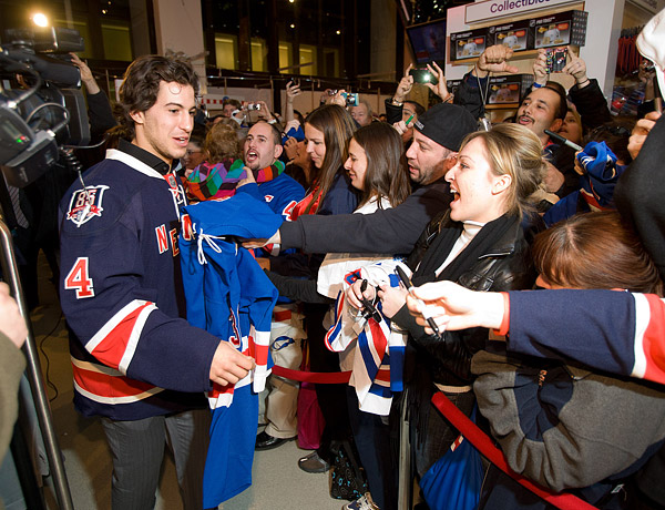 Rangers defenseman Michael Del Zotto is greeted by fans