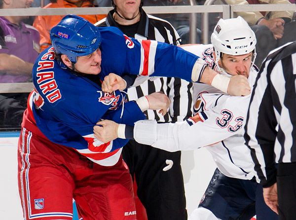 The Rangers' Derek Boogaard throws a punch at Steve MacIntyre during one of their two fights