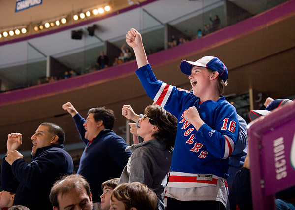 Rangers fans celebrate their team's offensive outburst