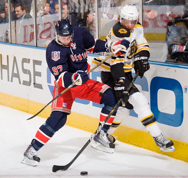Matt Gilroy and Boston's Blake Wheeler