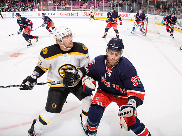 New York's Matt Gilroy braces for a hit from Boston's Michael Ryder