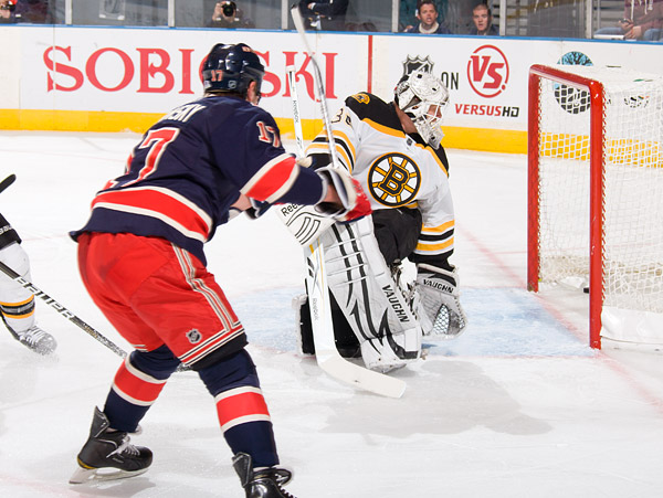 Brandon Dubinsky, scores the first goal for the Rangers against Bruins goalie Tim Thomas. Dubinsky leads the team in goals scored with 11