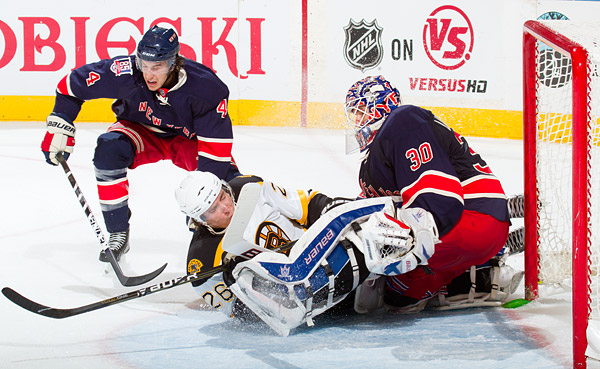 The Bruins' Blake Wheeler collides with Rangers goalie Henrik Lundqvist