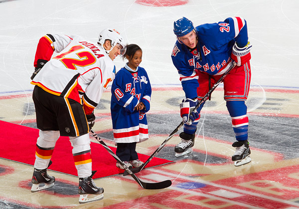 Participating in a ceremonial puck drop with the Rangers' Ryan Callahan and Flames' Jarome Iginla at center ice