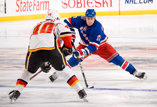 The Rangers' Brandon Dubinsky uses a nifty move to get past the Flames' Alex Tanguay