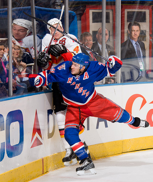 New York's Ryan Callahan checks Calgary's Jay Bouwmeester into the boards
