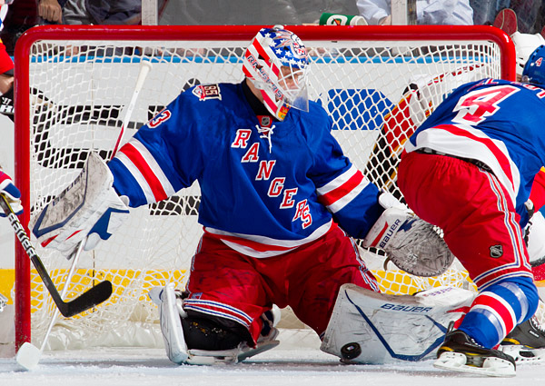 Rangers goalie Martin Biron makes one of his 31 saves