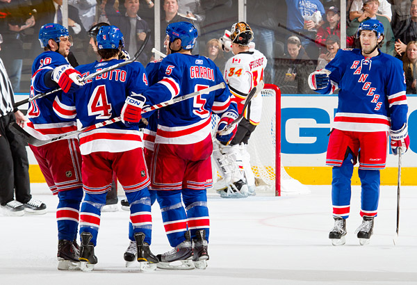 The Rangers celebrate Dan Girardi's game winning goal