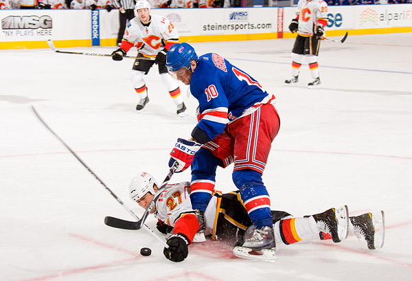 Calgary's Steve Staios tries to stop New York's Marian Gaborik the only way he knows how