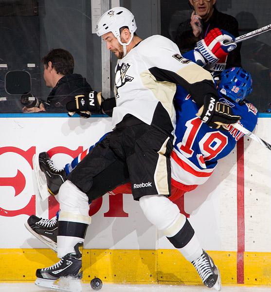 Pittsburgh's Deryk Engelland checks New York's Ruslan Fedotenko into the boards