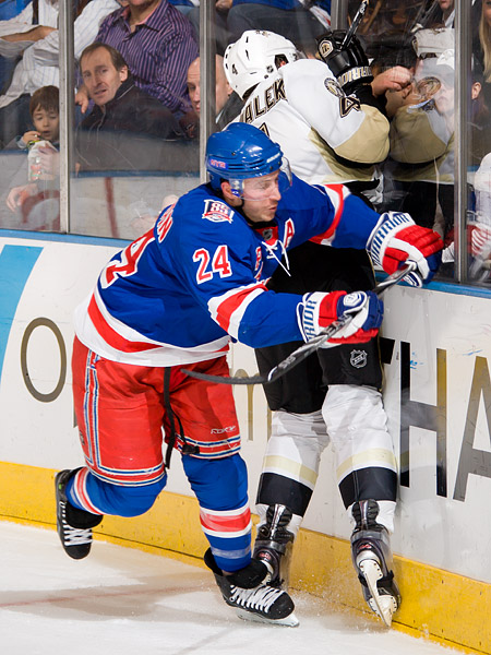 New York's Ryan Callahan checks Pittsburgh's Zbynek Michalek into the boards