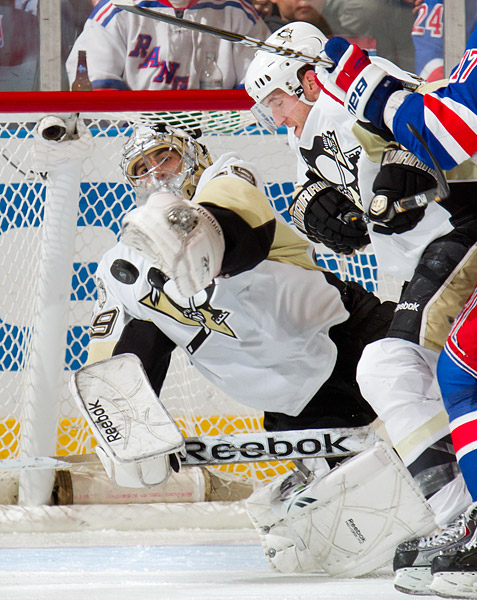 Penguins goalie Marc-Andre Fleury makes a diving save in the third period