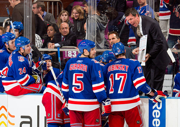 Rangers assistant coach Mike Sullivan draws up a play during his team's timeout late in the game