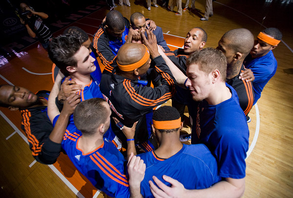 The New York Knicks in a huddle on the court before a game against the Atlanta Hawks.