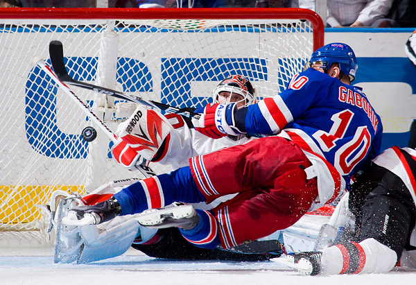 New Jersey Devils goaltender Martin Brodeur making a save against Marian Gaborik, the New York Rangers' 2009-2010 leading scorer, in a 1-0 Devils win.