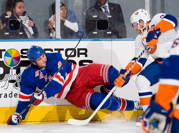 Derek Boogaard of the Rangers and James Wisniewski of the Islanders