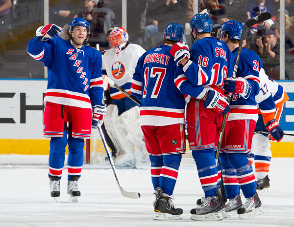The Rangers celebrate Marc Staal's game winning goal