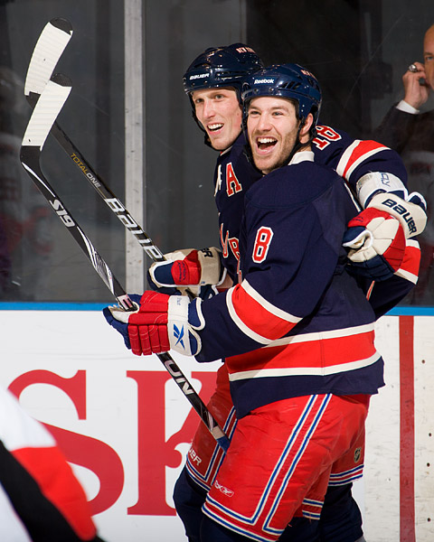 New York's Brandon Prust (#8) celebrates his goal with teammate Marc Staal