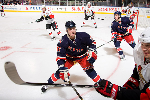 New York's Brandon Dubinsky prepares to check an Ottawa player