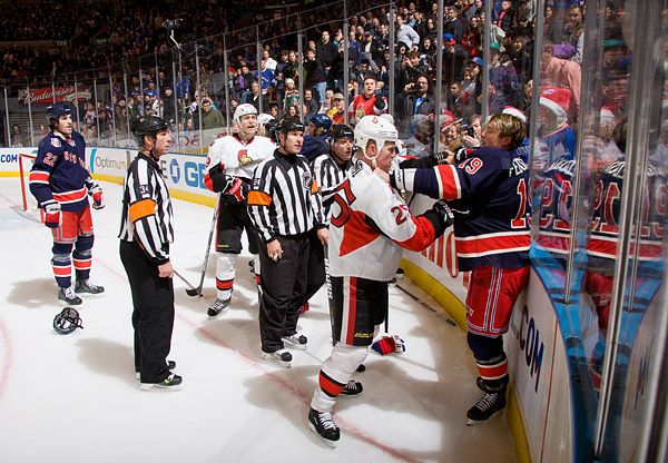 A scuffle breaks out between the Senators' Chris Neil and Rangers' Ruslan Fedotenko