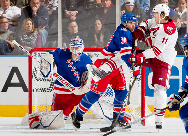 The Rangers' Michael Sauer pushes aside Coyote Martin Hanzal as goalie Martin Biron makes one of 30 saves