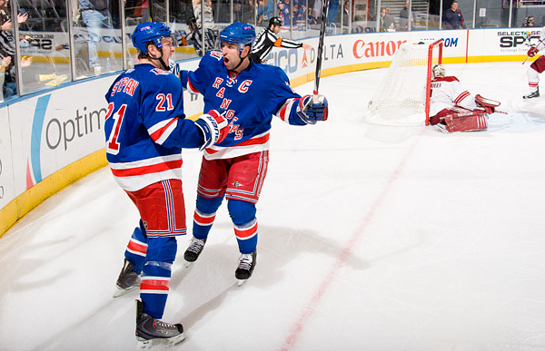 New York's Derek Stepan celebrates his game-tying goal with captain Chris Drury
