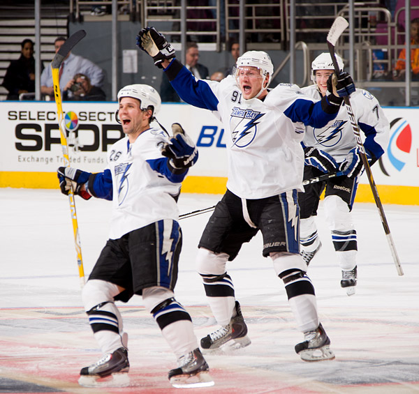 Tampa Bay's Martin St. Louis, Steven Stamkos and Brett Clark celebrate their victory