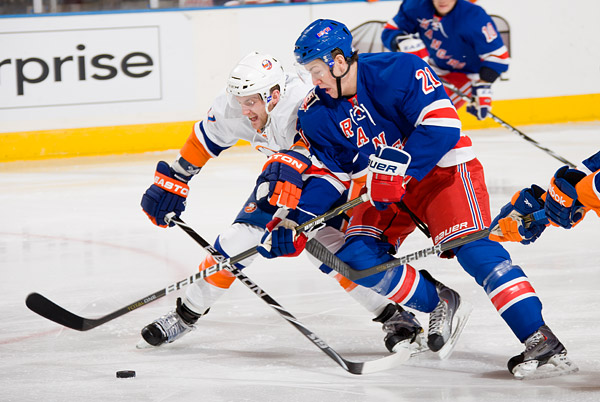 The Rangers' Derek Stepan and an Islanders defender