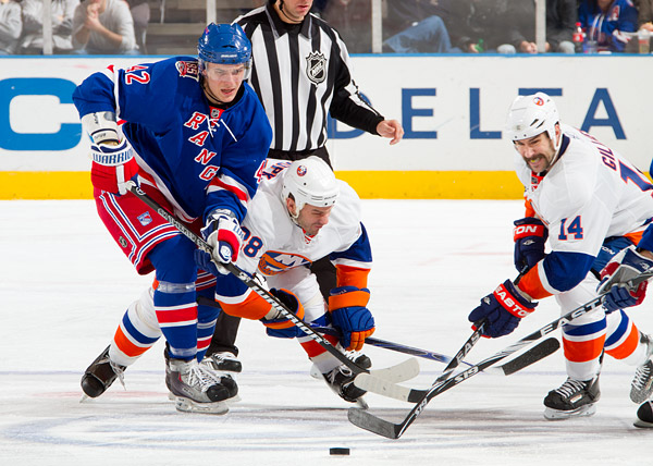The Rangers' Artem Anisimov and Islanders' Zenon Konopka and Trevor Gillies