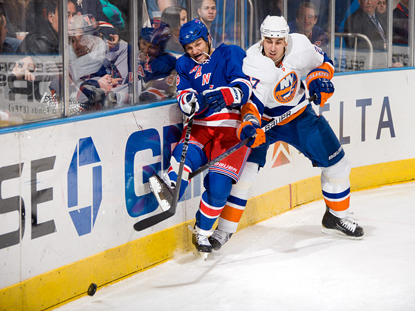 The Islanders' Milan Jurcina checks the Rangers' Sean Avery