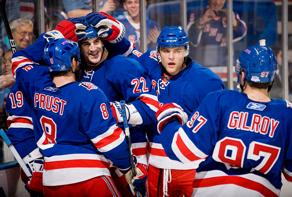 The Rangers' Matt Gilroy (#97) and Brian Boyle (#22), seen here celebrating a goal by Ruslan Fedotenko (#19), combined for 3 goals and 2 assists and were named the #1 and #2 stars of the game