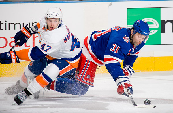 The Rangers' Alex Frolov makes a play against the Islanders' Andrew MacDonald