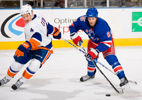 The Islanders' Mark Eaton and Rangers' Brandon Prust