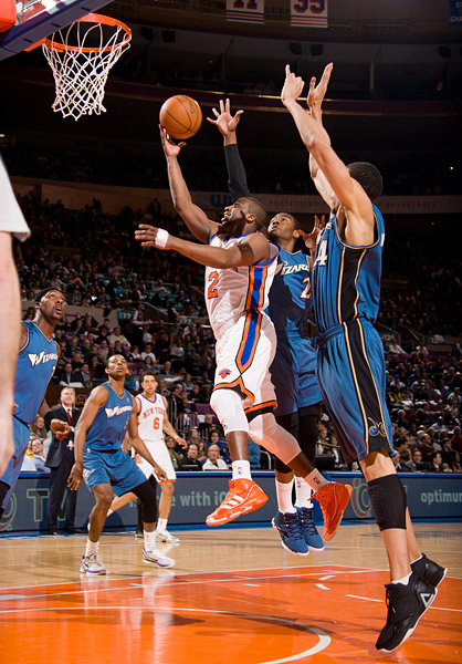 New York's Raymond Felton drives past Washington's John Wall and JaVale McGee