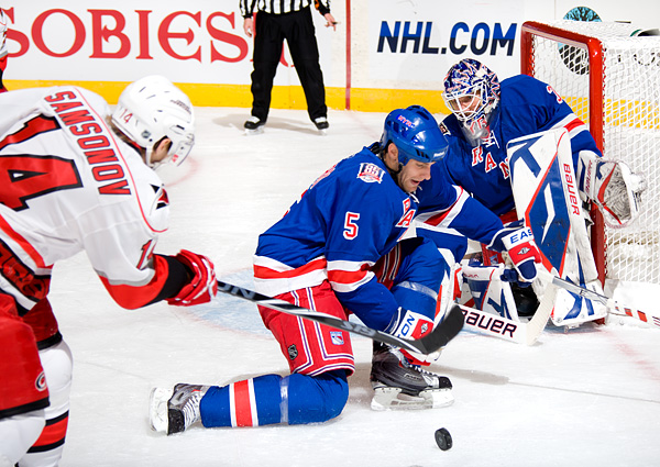 New York's Dan Girardi blocks a shot by Carolina's Sergei Samsonov