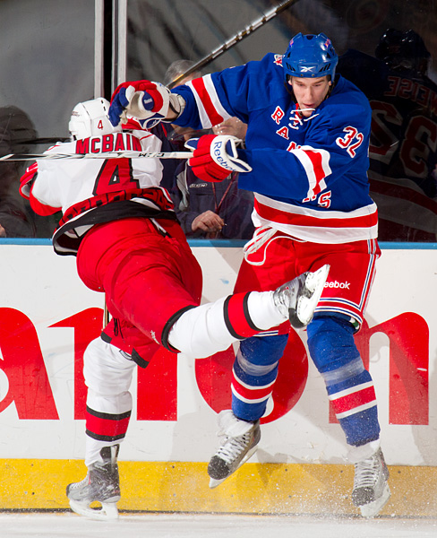 Rangers rookie Dale Weise, playing in his first game at Madison Square Garden, pushes aside the Hurricanes' Jamie McBain