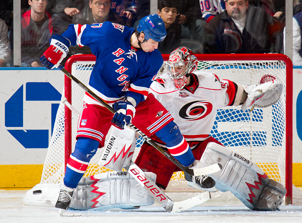 The Rangers' Brandon Dubinsky tries to deflect a shot past Hurricanes goalie Cam Ward