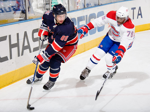 Newly acquired Rangers forward Wojtek Wolski and the Canadiens' P.K. Subban