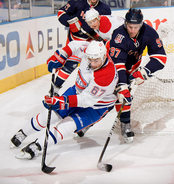 The Rangers' Matt Gilroy defends against the Canadiens' Max Pacioretty