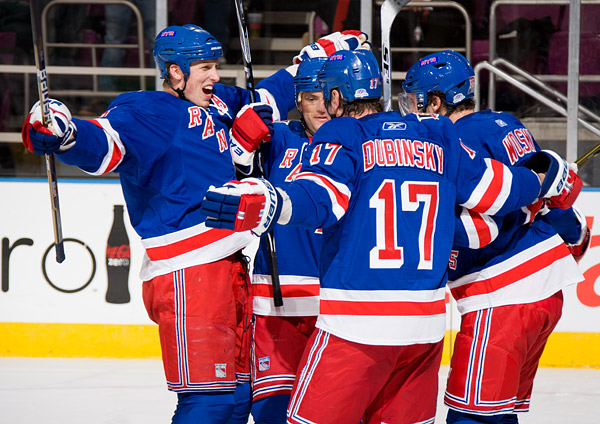 Marc Staal, Marian Gaborik, Brandon Dubinsky and Wojtek Wolski celebrate Wolski's goal, his first as a Ranger