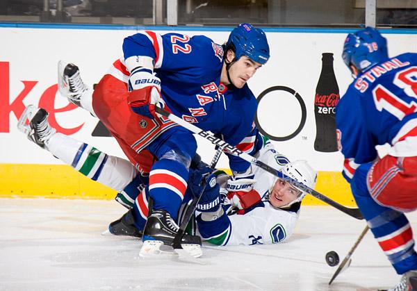 The Rangers' Brian Boyle and Canucks' Alexandre Burrows