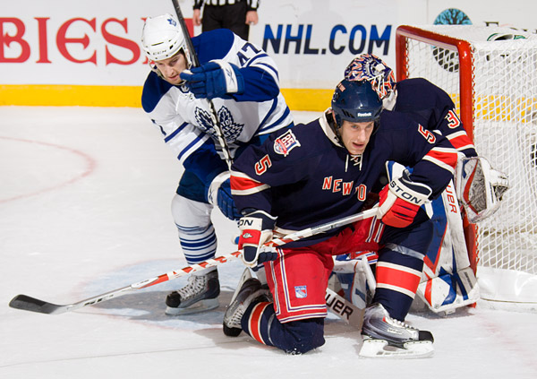 Rangers defenseman Dan Girardi sets up to block a shot in front of the goal