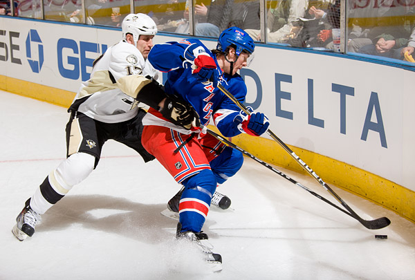 Rangers defenseman Ryan McDonagh keeps the puck from the Penguins' Michael Rupp
