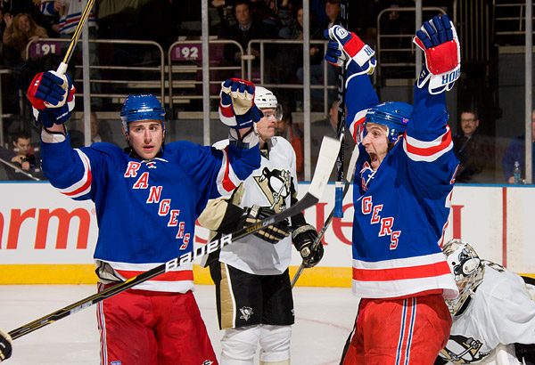 New York's Brandon Dubinsky and Ryan Callahan celebrate Callahan's game-tying goal in the second period