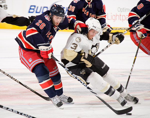 New York's Erik Christensen and Pittsburgh's Alex Goligoski