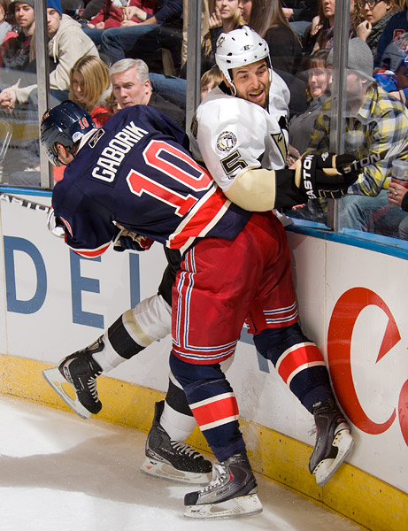 New York's Marian Gaborik checks Pittsburgh's Deryk Engelland into the boards
