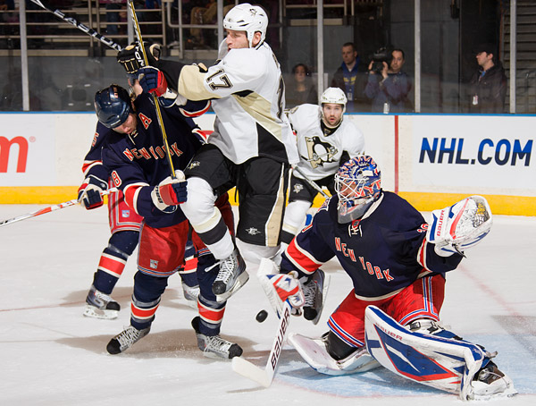 Rangers goalie Henrik Lundqvist makes a save behind teammate Marc Staal and Pittsburgh's Michael Rupp