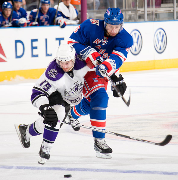 The Kings' Brad Richardson battles for the puck possession with the Rangers' Wojtek Wolski