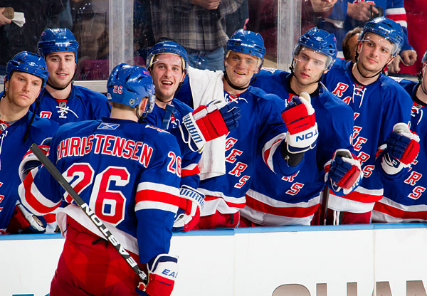 Erik Christensen gets some love from his Rangers teammates after scoring the opening shootout goal, improving his season shootout record to a perfect 4 for 4