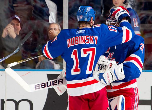 Brandon Dubinsky congratulates goalie Henrik Lundqvist on his 200th career victory